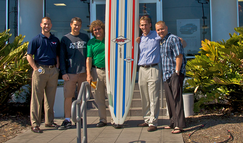 Cox Family with Surfboard