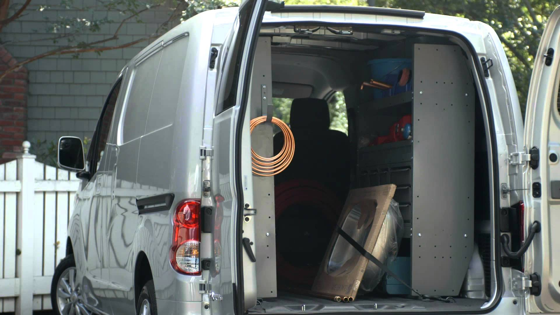 interior of Chevrolet Express van showing sink and various contractor tools