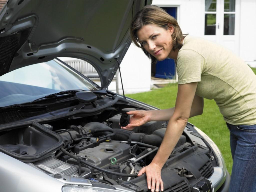 woman checks oil