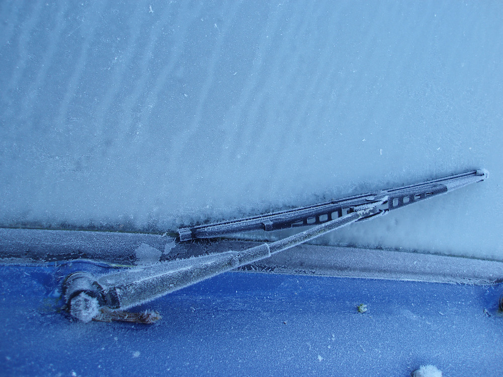 a wiper blade frozen onto the windscreen of a car