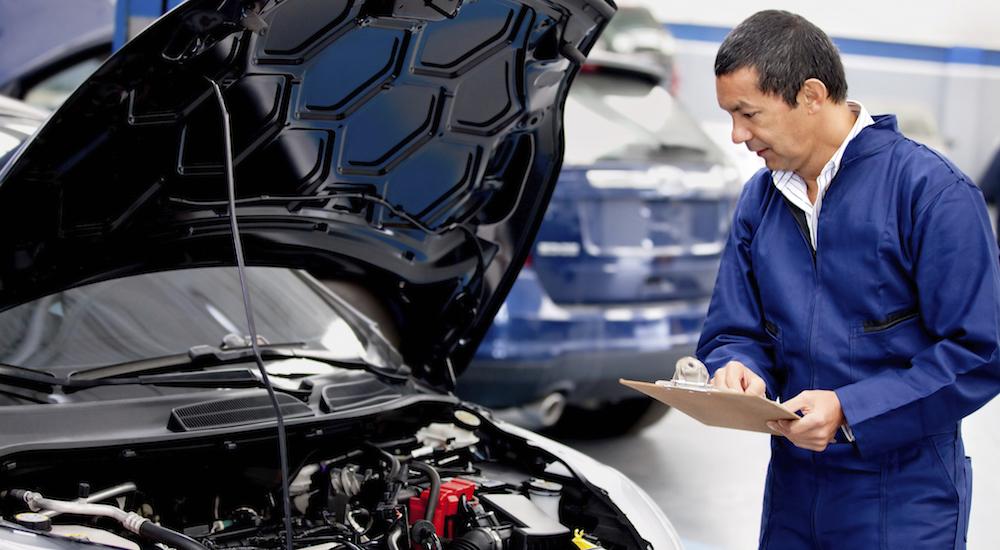 Mechanic checking on a car
