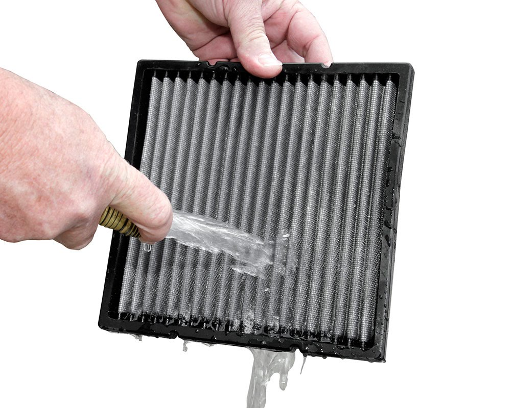 Automotive Air Filter being cleaned