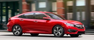 Side view of a red exterior 2017 Honda Civic Sedan