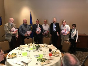 Carol from Mercedes-Benz of Draper presenting books to the veterans of our Provo Rotary Club.