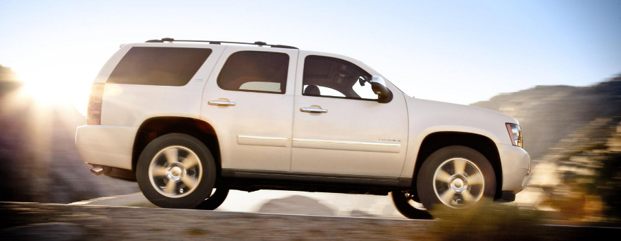 Used White Tahoe Driving