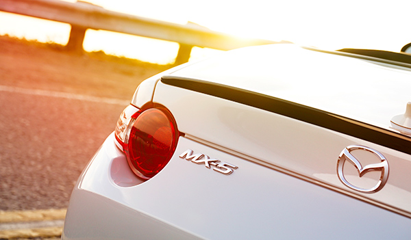 Sun hitting MX-5 logo